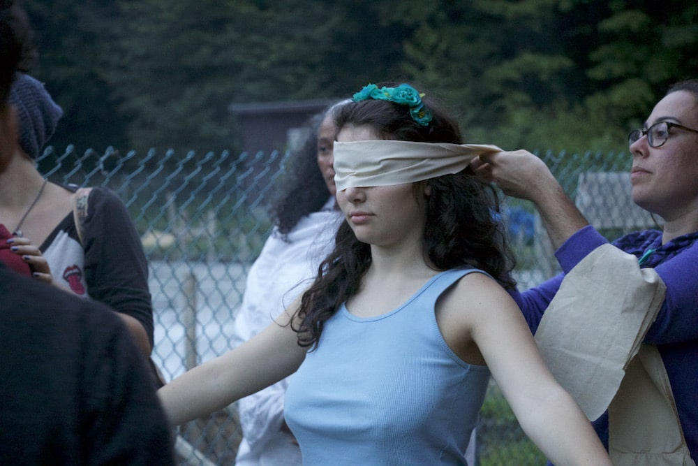 Camper being blindfolded right before a blindfolded dance event at camp