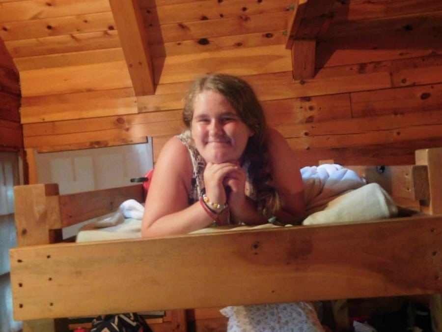 Ava laying on her cabin bunk bed