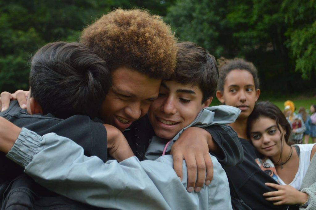 Campers hugging at Odyssey Teen Camp