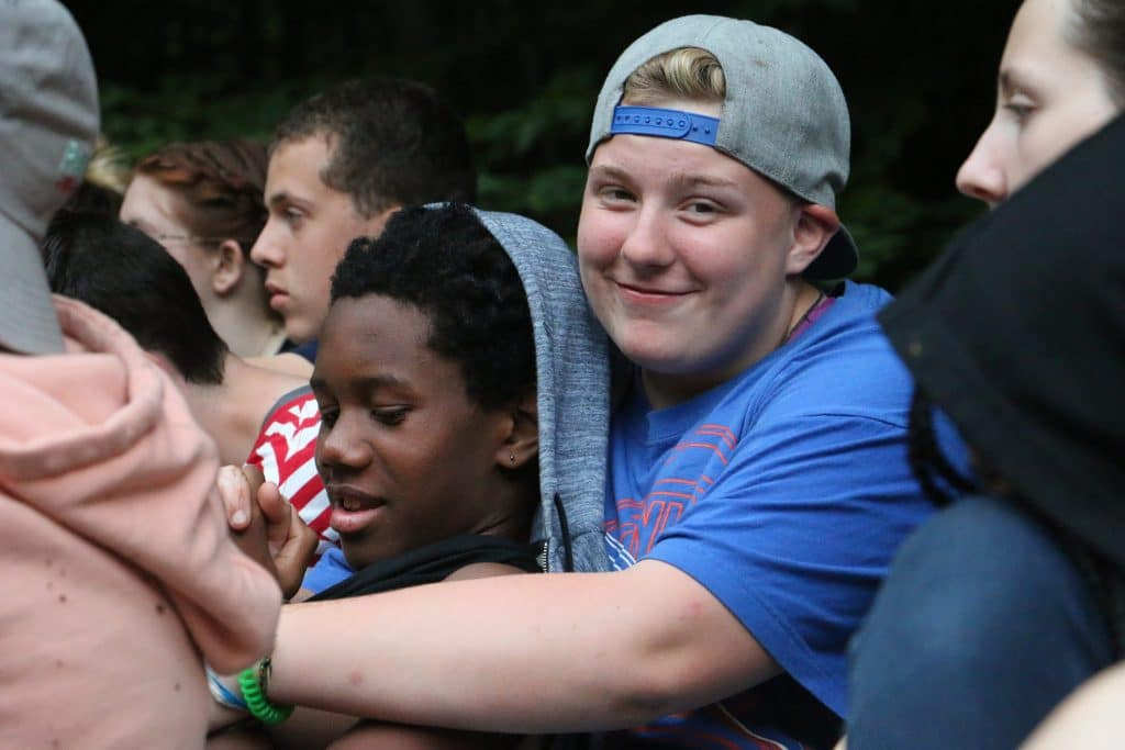 Campers at OTC embrace.