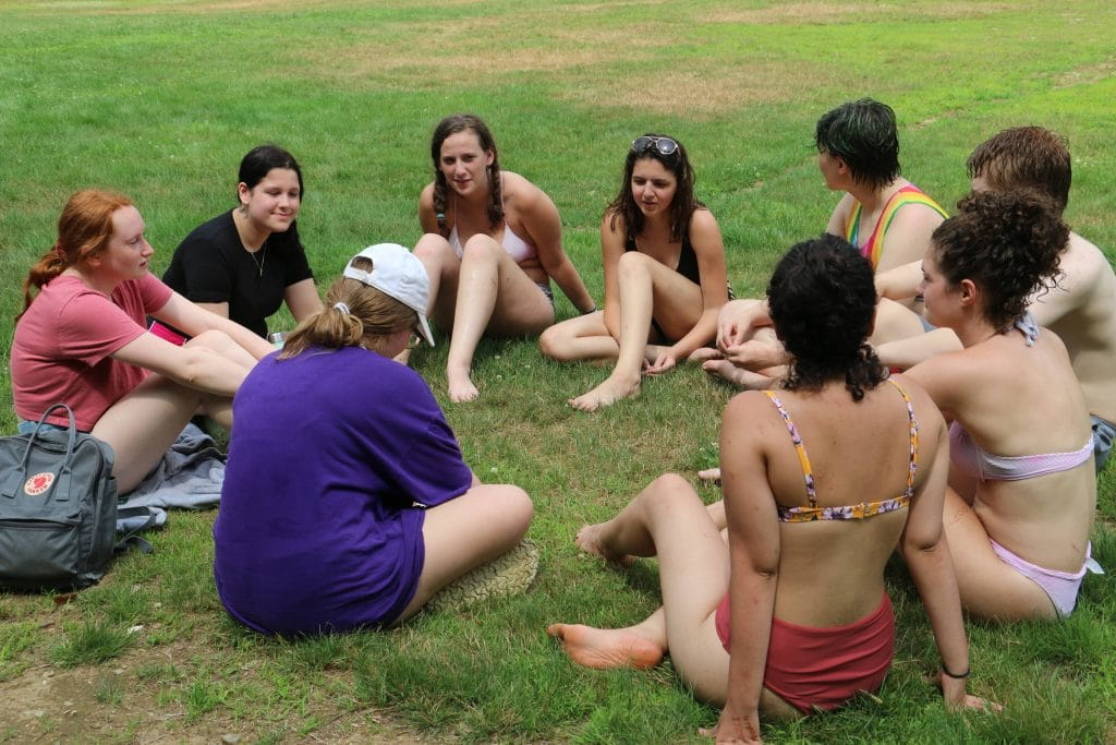 Sharing circle at camp.