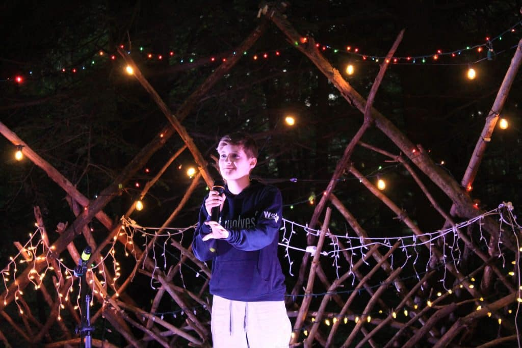Camper with microphone on stage